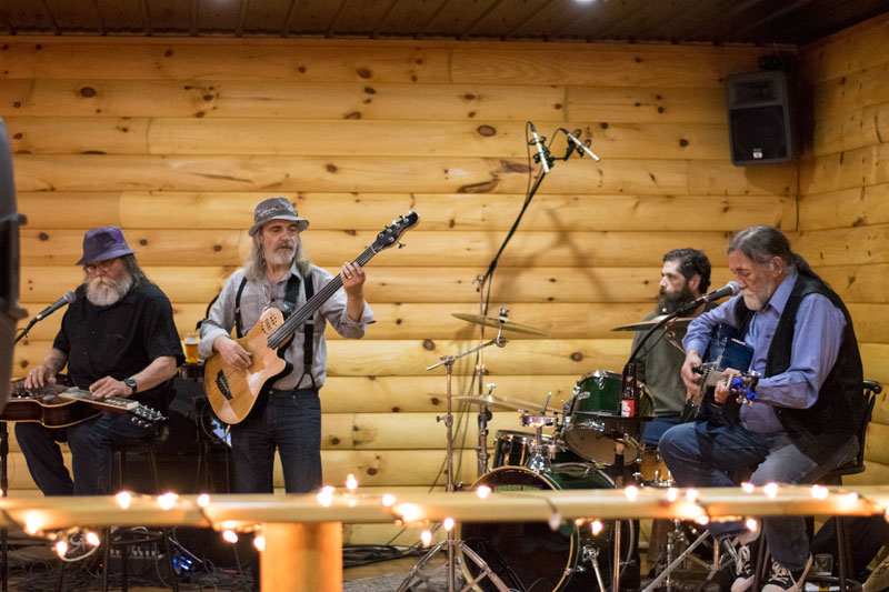 Photo of The Johnny Jules Band at Zak's Wilderness Lounge with guitar bass drums